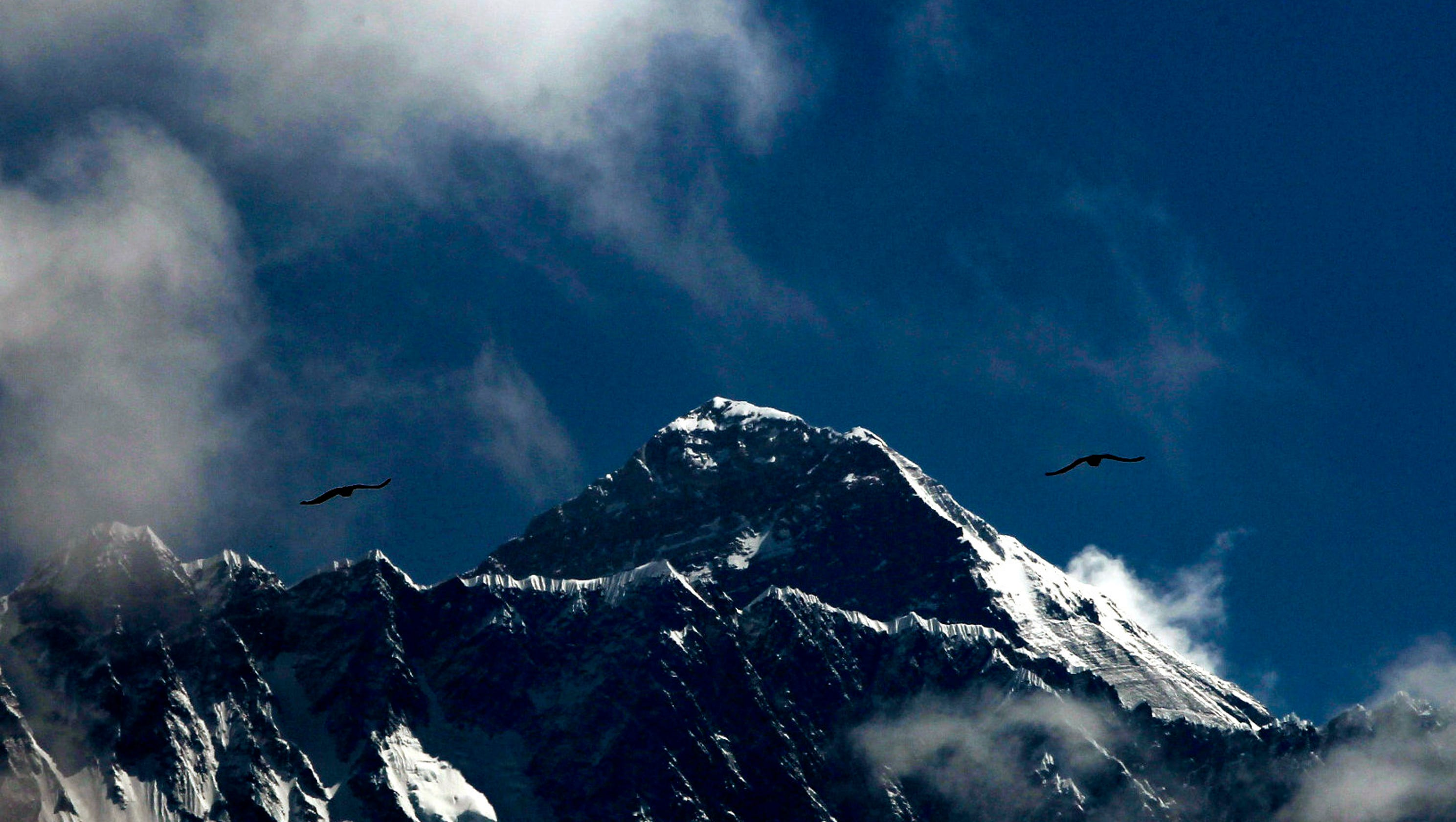 Deaths rise as Nepal issues more permits for Mount Everest