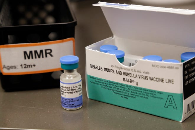 In this photo taken Wednesday, May 15, 2019, a dose of the measles, mumps and rubella vaccine is displayed at the Neighborcare Health clinics at Vashon Island High School in Vashon Island, Wash.