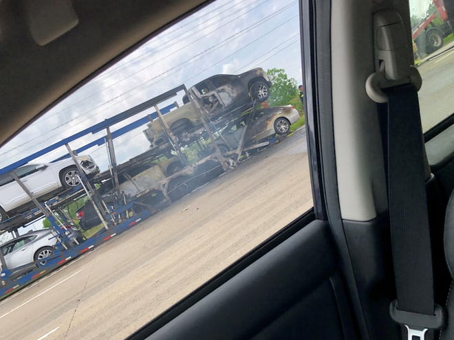 A car hauler caught fire on southbound I-75 at West Road in Woodhaven, closing the freeway Tuesday, May 28.