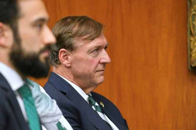 Samuel Stanley Jr. listens during a Michigan State University meeting where the board of trustees is expected to name him university president, May 28, 2019