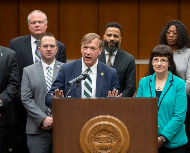 Samuel Stanley Jr., surrounded by faculty, trustees, and members of the search committee, speaks to the audience after a special session of the Michigan State University board of trustees voted to elect Stanley as the university's 21st president Tuesday.