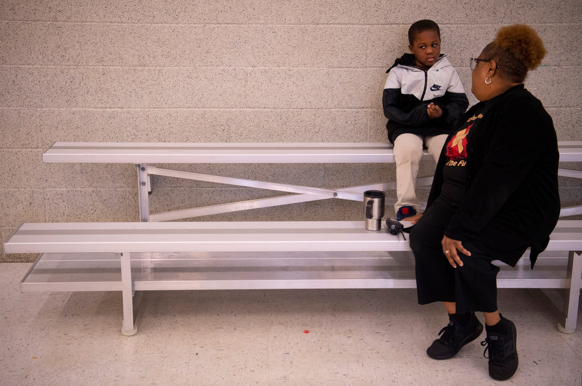 Pam Decker has a time-out talk with Antwan Howard in the school's gym during Joshua Academy's field day Friday, May 10, 2019. The 40-year education veteran wears a variety of hats in her role as CEO of the school.