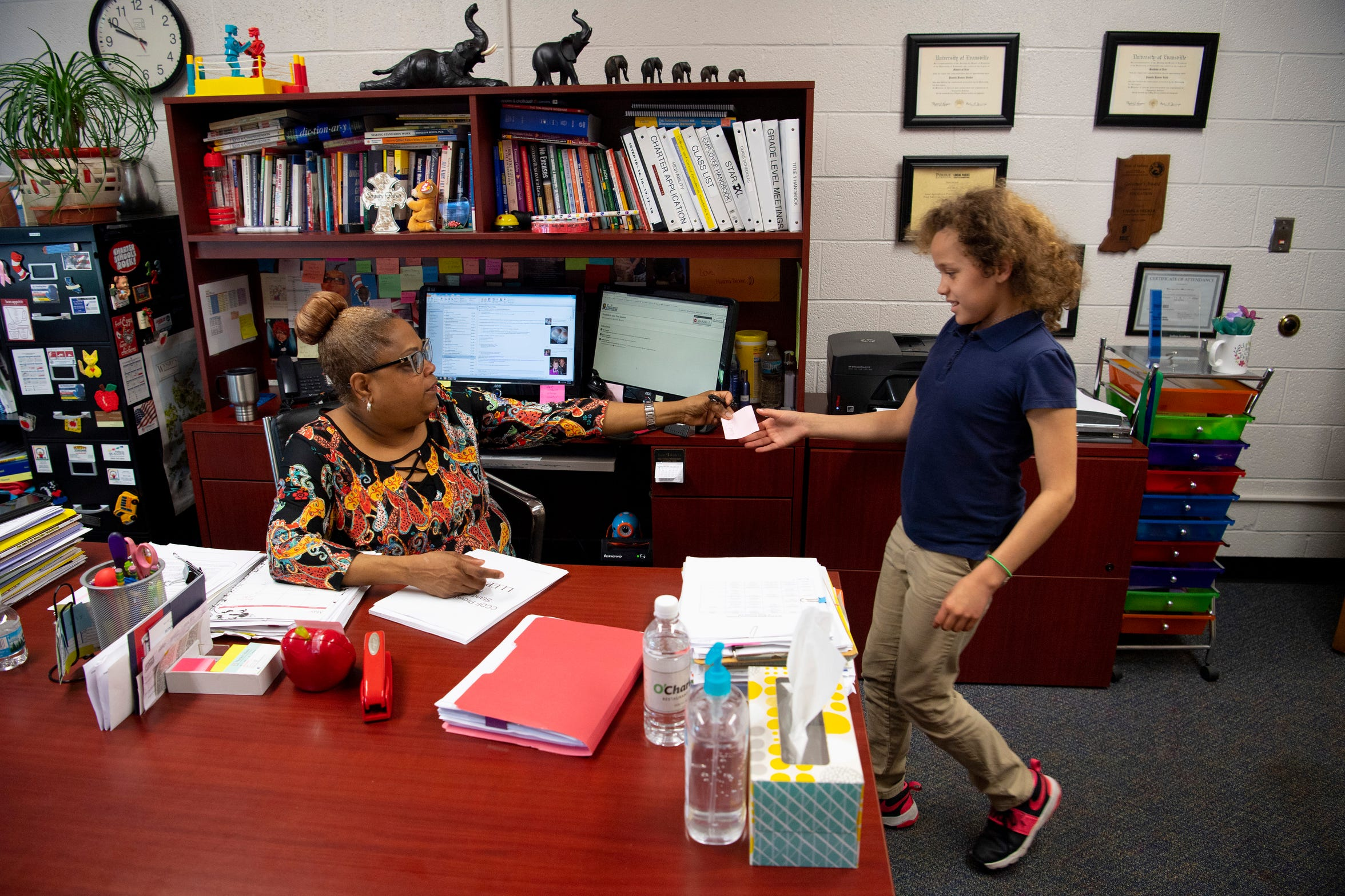 Joshua Academy's Pam Decker's many duties include administering year-end tests for students, including 4th-grader Akeleigh Frazier-Evans who was ready to take her's in the room next to Decker's Monday, May 7, 2019.