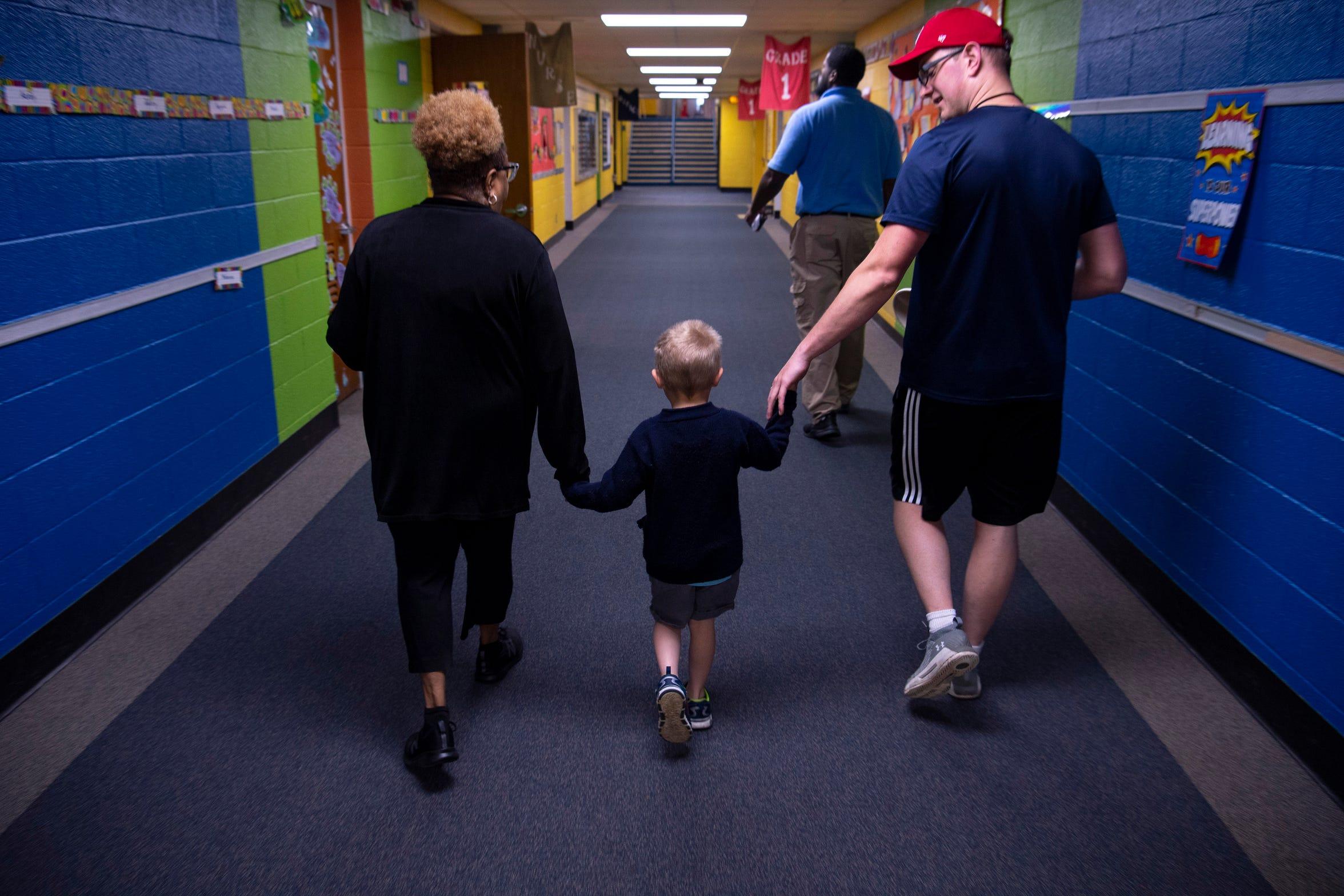 Pam Decker and Jeremy Rittenbery, PE teacher, walk kindergartner Gabriel Bennet to the nurses office after he took a fall during Joshua Academy's field day Friday, May 10, 2019.