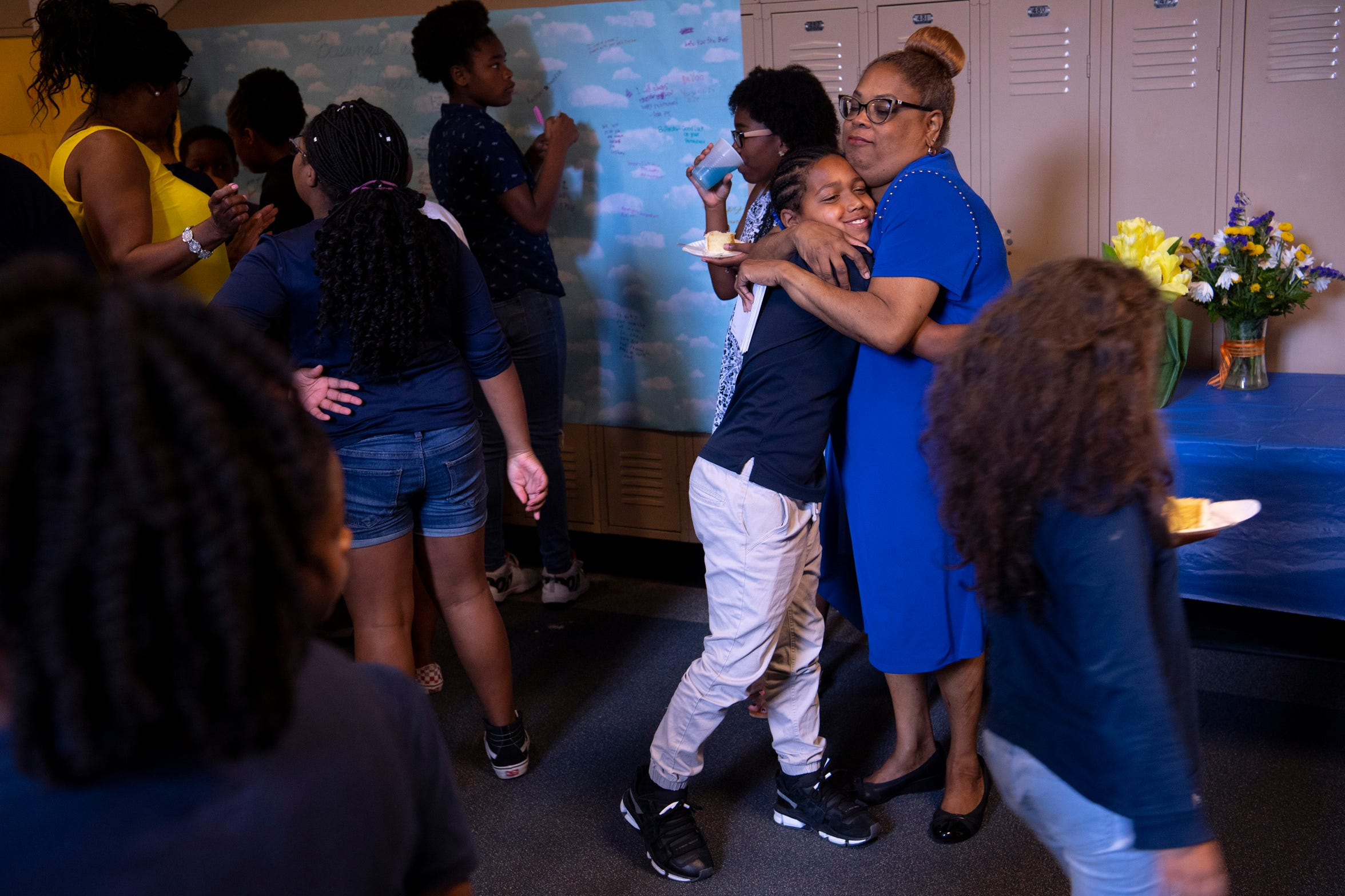 Kingston Chambers receives a hug from Pam Decker at her Joshua Academy retirement party Friday, May 24, 2019. Cake and blue punch were served to the students as they semi-orderly arrived with their classes to say goodbye to their past principal on the last day of school.