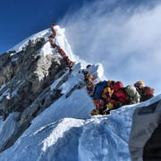 Hundreds of climbers line up on the Cornice-Traverse just below the summit of Mount Everest in this May 22 photo.