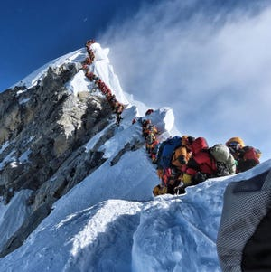 Hundreds of climbers line up on the Cornice-Traverse and Hillary Step just below the summit of Mount Everest in this May 22 photo.
