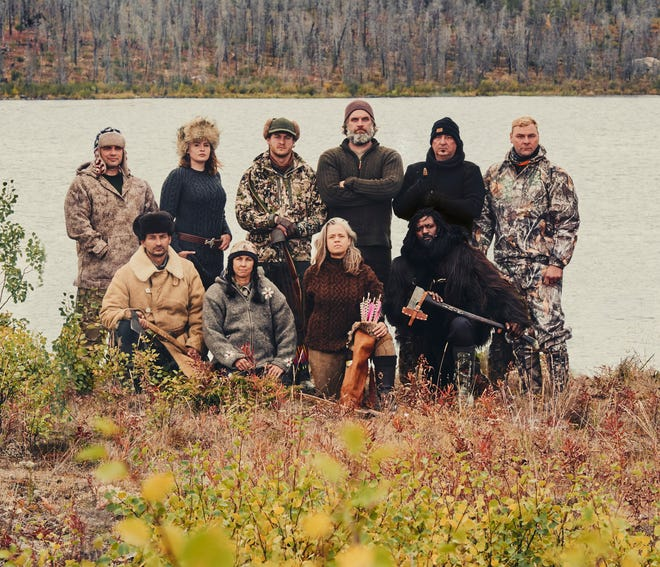 "Barry Karcher, far right, is pictured with his nine competitors on the survival show, ""Alone."""