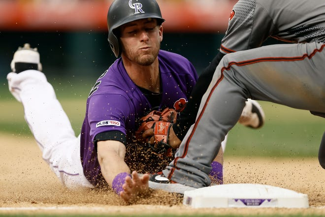 Ryan McMahon, shown trying to beat a tag at third base during Monday's game, and the Colorado Rockies will continue a 10-game homestand with games  at 6:40 Wednesday and 1:10 p.m. Thursday against the Arizona Diamondbacks at Coors Field.