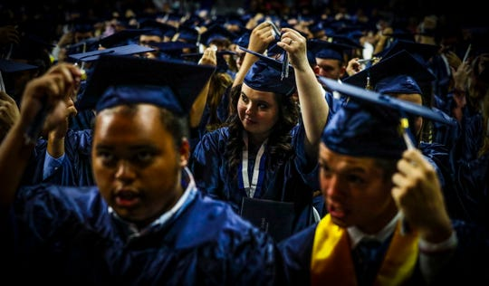 After just walking the stage to receive their diplomas, graduates move their tassels to the left side of their cap. Estero High School seniors were excited to graduate Saturday morning during their  graduation ceremony at Alico Arena, Estero, FL. About 420 students participated in the ceremony.