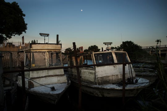 Fishing boats sit tied up off of  Lake Okeechobee in Clewiston on Thursday May, 16, 2019. The Centers for Disease Control is doing research on the affects of blue green algae on people who work and live on or along Lake Okeechobee. The fishermen who work on the boats are the people the CDC will be looking for to do research on.
