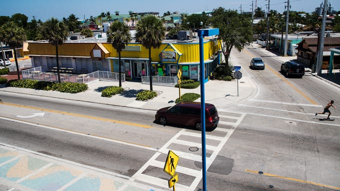A skateboarder rides past some of the businesses Tuesday May, 28, 2019 that will be torn down as part of the Margaritaville resort that is being built by TPI Hospitality.