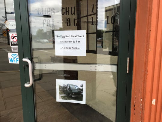 A sign on the door indicates Egg Roll Plus Food Truck plans to open a restaurant and bar in the Broadway District space formerly home to Maria's Mexican Restaurant.