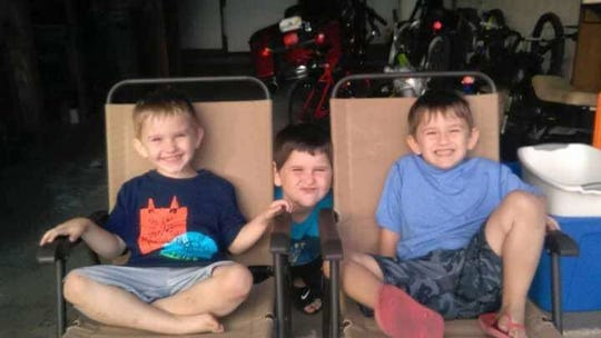 Twin brothers, Dylan Clark, right, and Camryn Clark, left, sit with their older brother, Billy Clark Jr. The twins died in a DUI-related vehicle crash involving their mother in Pickens County. They were 6.