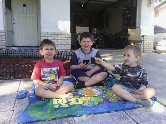Twin brothers, Dylan Clark, left, and Camryn Clark, right, sit with their older brother, Billy Clark Jr. The twins died in a DUI-related vehicle crash involving their mother in Pickens County. They were 6.