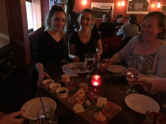 Cassie and Amber Coburn bring a charcuterie board to the table at The Jawbone in White Sulphur Springs.