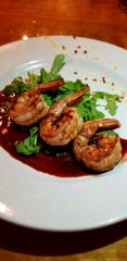 Shrimp in pomegranate sauce are among the small plate options at The Jawbone in White Sulphur Springs.