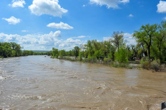 The Sun River reached 9 feet on Tuesday causing flooding in the town of Sun River.