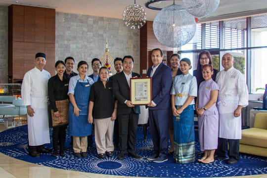 Dusit Thani Guam Resort successfully completed requirements for ISO 9001:2015 certification. Pictured from left: Chalong Sakkapalangkul, executive sous chef; Shayna Mangatmag, Soi server; Pakka Lizel De La Cruz, Aqua server; Marichu Silva, public area attendant; Joel Sanchez, total quality manager; Dean Huntsman, general manager; Stephanie Macaraeg, greeter; Kathleen Edward, spa therapist; Christian Panganiban, chef de cuisine; (back row) Robbie Gaetus, events coordinator; Christopher Cortezano, assistant rooms director; Edison Panganiban, asst. IT manager; Raizelle Hilario, engineering coordinator; Wennie Yang, human resources manager.