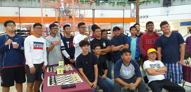 The John F. Kennedy High School chess players dominated the 2019 National Students Rapid Chess tournament held May 17 at Micronesia Mall, Dededo. Seven players from JFKHS were among  the top 10. Leading the bunch of players from JFK High School was Marion Tuazon, 16, sophomore student  who won the tournament with a perfect score of 5 points. Second was Shambach Sairus; JFK, Taisacan Randy Jese Jr.; JFK, Tamonte Cole; JFK, Sarmiento Cyle Renzo; FBLG, Tamonte Caden; JFK, Doria Daniel; JFK, Almazar Jude Vinyl; JFK, Epres Luineo; St. Pauland in tenth place was Remitina Jehu Ruel; GCC.