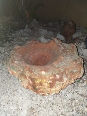 Pictured is one of the potential artifacts found in the back parking lot of the Outrigger Hotel. Hila'an San Nicolas stumbled upon them on his way to the beach Monday morning. The State Historic Preservation Office began an investigation Tuesday morning. Construction activity at the hotel is halted.