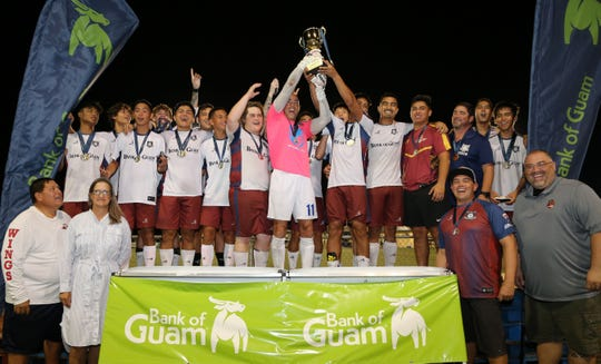 The Bank of Guam Strykers hoist the champion trophy of the Bank of Guam 12th Annual GFA Cup after defeating the NAPA Rovers FC 5-1 in the tournament's title match Sunday evening at the Guam Football Association National Training Center. The 2019 GFA Cup title is the second straight for the Strykers.