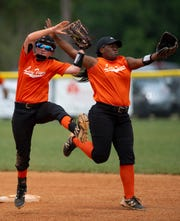 Hopkinsville's Kaitlyn Kaetzel, left, comes up with the Webster County pop-fly while narrowly avoiding a collision with teammate Taiya Straight during the Region 2 Tournament at the Clarky Clark Athletic Complex in Dixon, Ky., Monday afternoon.