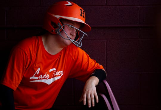 Hopkinsville's Sabrina Hodge waits to bat in the dugout with her team down 11-0 against Webster County in the fifth inning of their Region 2 Tournament game at the Clarky Clark Athletic Complex in Dixon, Ky., Monday afternoon.