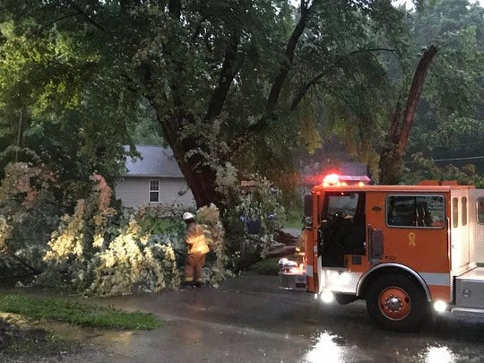 Strong winds amid a tornado warning around 8:45 p.m. Monday, May 27, 2019, brought down a large tree across High Street in Middletown.
