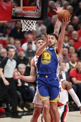 May 20, 2019; Portland, OR, USA; Golden State Warriors guard Klay Thompson (11) shots over Portland Trail Blazers forward Meyers Leonard (11) in the first half of game four of the Western conference finals of the 2019 NBA Playoffs at Moda Center.