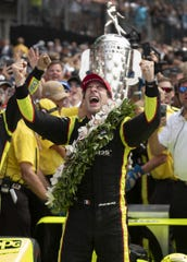 Simon Pagenaud (22) of Team Penske celebrates winning the Indianapolis 500 at Indianapolis Motor Speedway on Sunday, May 26, 2019.