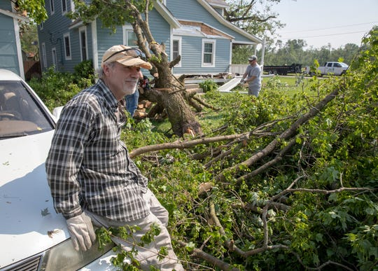 Jeff Lovell surveys damage to his house in Pendleton, where a tornado landed the previous evening, Tuesday, May 28, 2019. No injuries were reported, and property and tree damage were extensive in the area.