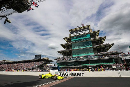 Simon Pagenaud (22) of Team Penske crosses the finish line to win the 103rd running of the Indy 500 at Indianapolis Motor Speedway, Sunday, May 26, 2019.