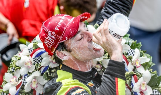 After winning the 103rd Indianapolis 500, IndyCar driver Simon Pagenaud takes a drink of milk on Sunday, May 26, 2019.