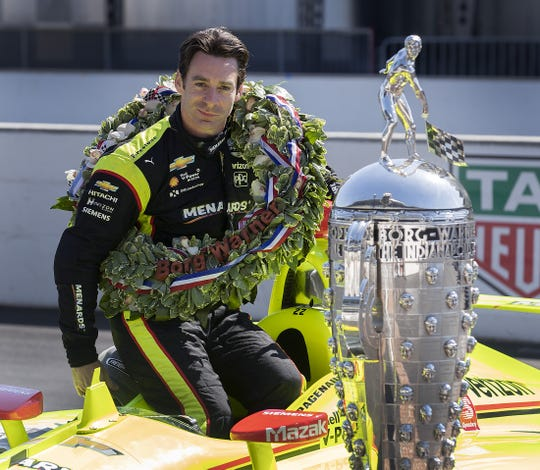 Simon Pagenaud, winner of the 103th Indianapolis 500, poses for photos on the yard of bricks with the Borg-Warner Trophy at Indianapolis Motor Speedway on Monday, May 28, 2019.