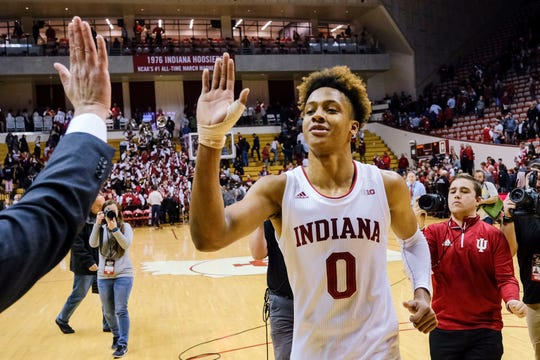 Indiana guard Romeo Langford gets a high-five from a member of the basketball staff after the team's NCAA college basketball game against Wisconsin in Bloomington, Ind., Tuesday, Feb. 26, 2019. Indiana won 75-73 in double overtime.