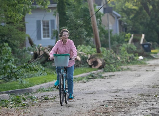A resident surveys damage to Pendleton, where a tornado landed the previous evening, Tuesday, May 28, 2019. No injuries were reported, and property and tree damage was extensive in the area.