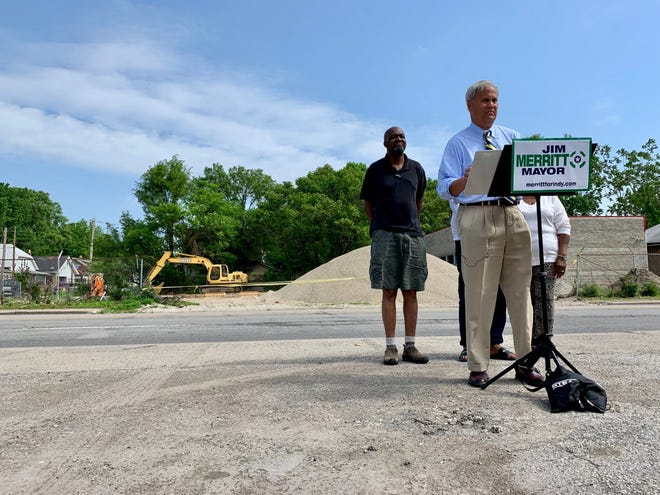 State Sen. Jim Merritt, the Republican challenger to Mayor Joe Hogsett, pushed for nine debates against the incumbent during a press conference in Haughville on May 28, 2019. Standing beside him is Henri Gaither, a nearby resident.