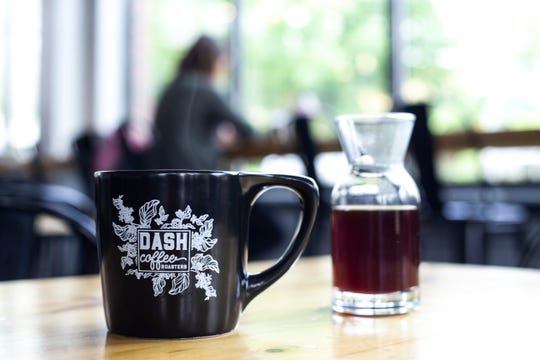 Steam rises from a cup of pour over coffee with a decanter of of additional coffee at right, Tuesday, May 28, 2019, at Dash Coffee Roasters, 287 N. Linn Street, in the Northside District of Iowa City, Iowa.
