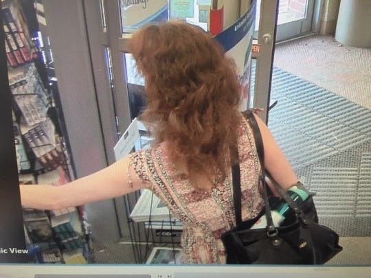 A larceny suspect is described the as a 40 to 50-year-old woman with long, light brown wavy hair and she was wearing a patterned sundress and carrying a black bag at the time of the theft.