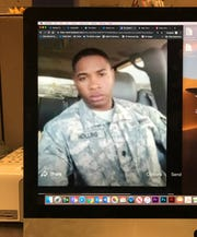 This photo of a computer screen shows a photo of James Hollins in a Facebook post.