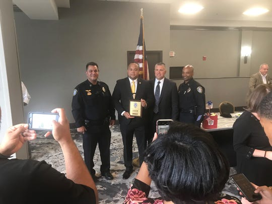 Nick Donald gets his picture taken after winning the Officer of the Year Award with Jackson Police Chief Julian Wiser and deputy chiefs Tyreese Miller and Barry Michael at the Doubletree Hotel.