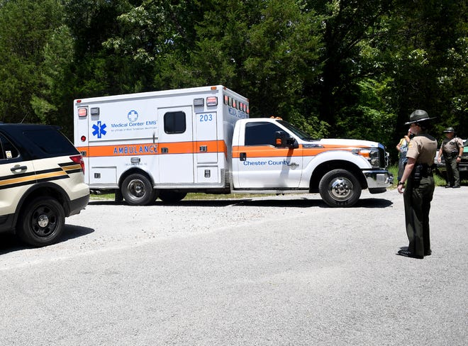A Tennessee State Trooper directs an ambulance in traffic Tuesday afternoon after the search for missing 2-year-old Levi David Northcott ended. Northcott was found unharmed and was transported to Jackson-Madison County General Hospital for check-up.