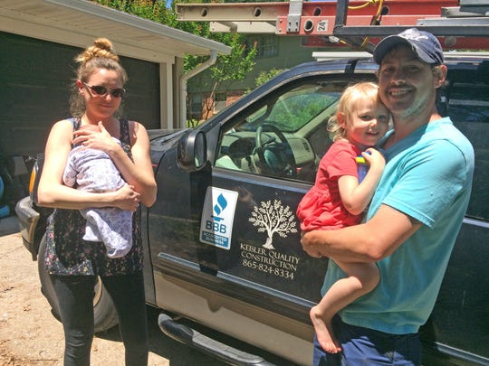 Aaron Keisler (holding 3-year-old Emily) and his wife, Amanda (with newborn Willow), have built a life together focused on Aaron's construction business.