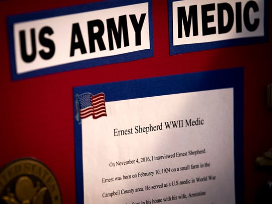 A project display board a local student made on Ernest Shepherd, who served as an Army medic during World War II and treated soldiers wounded during D-Day.
