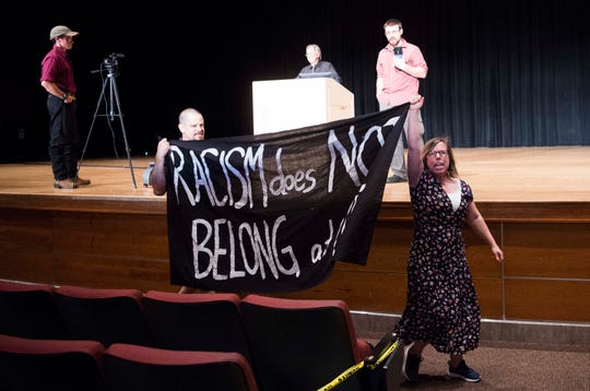 "Protestors chant ""No racism at UT"" before being ejected from the auditorium during Rick Tyler talk, ""White Nationalism: Fact or Fiction"" in the Alumni Memorial Building on University of Tennessee's campus in Knoxville, Tuesday, May 28, 2019. Tyler ran for congress in 2016 under the slogan ""Make America White Again."""