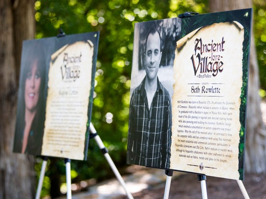 Biographical placards of artisans and other people involved with Ancient Village Lore are displayed during an event at the site of Ancient Lore Village in South Knoxville on Tuesday, May 28, 2019.