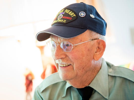 Ernest Shepherd, photographed here in his Knoxville home on Tuesday, May 28, 2019, served as an Army medic during World War II and treated soldiers wounded during D-Day.