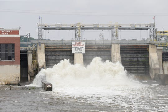 Water flows out of the Norway Dam into the Tippecanoe River, Tuesday, May 28, 2019, in Monticello.