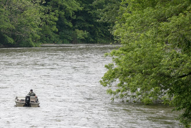 A DNR officer boats down the Tippecanoe River near the Norway Dam, Tuesday, May 28, 2019, in Monticello.